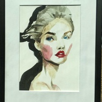 A framed aquarelle of a blueeyed lady