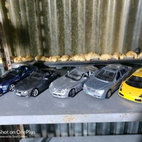 5 model cars in good condition.