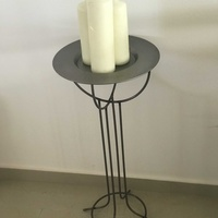 Real nice metal stand and plate with candles with surrounding pebbles