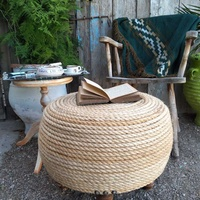 Braided natural indoor or outdoor pouf.