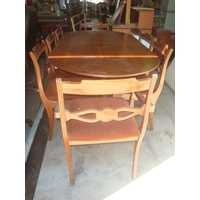Dining table with eight upholstered match