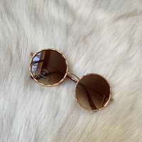 Brown round circle sunglasses with rose gold frame