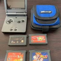 Nintendo advance sp console with cover and charger and 4 games