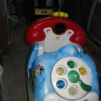 Coin operated telephone car kiddie ride