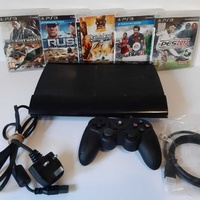 Ps3 super slim with 5 games and 1 controller