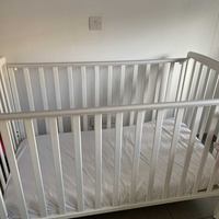 Two cots in very good condition including mattress