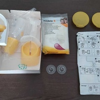 Medela mini electric breast pump with many extras