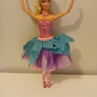 Barbie pink shoes doll.