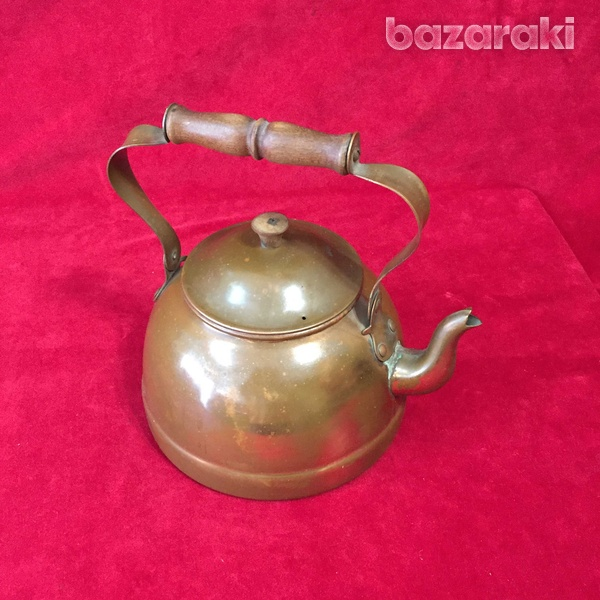 Vintage copper kettle with wooden handle.-1