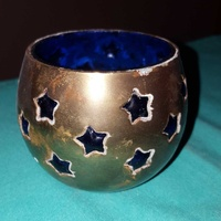 Brass candle holder with star decor