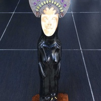 Unique black hardwood lady statue on elephants