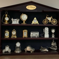Collection of 16 miniature silver and gold colourclocks le temps with wood baze