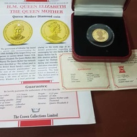 24ct solid gold coin with diamond