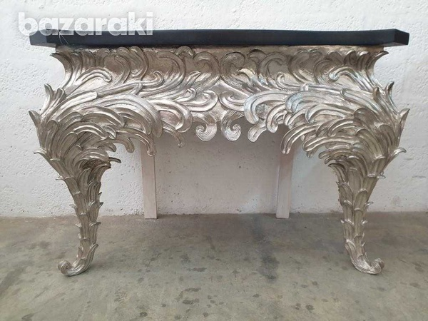 A console table, shaped black top on an eleborate silvered base-3
