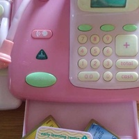 Toy cash register and 100 plastic toy foods