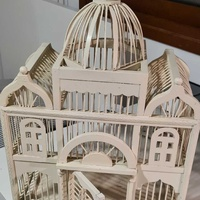 Decorative wooden cage for birds.