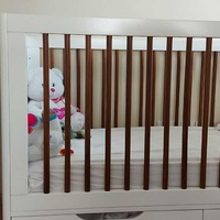 2 baby beds with mattresses & 1 drawer