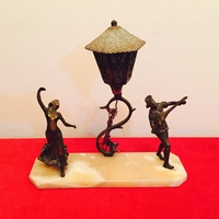 Solid brass figurines on onyx base