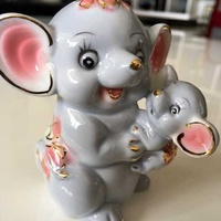 Lladro style mother and baby elephants