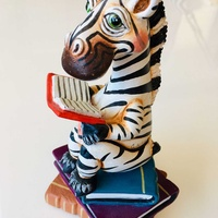 Unique reading zebra statue
