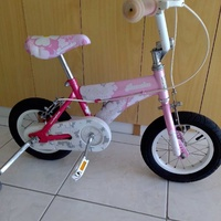 Bicycle for child with side wheels excellent condition like brand new.
