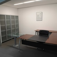 Executive desk with side extension round conf facility