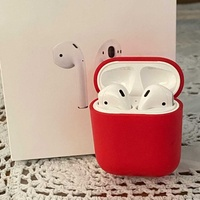 Airpods with charging case and red cover case