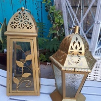 Set of decorative candles lanterns with glass.