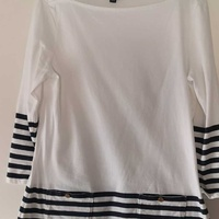 Tommy long sleeve top with two pocket detailing. size medium