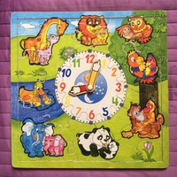 Wooden puzzle with clock