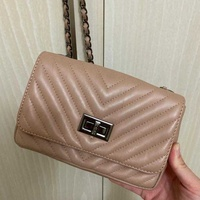 Small leather beige bag on the chain