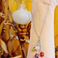 A 9k white gold necklace with precious stones