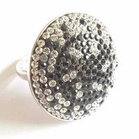 Sterling silver ring with round face set with clear and black stones