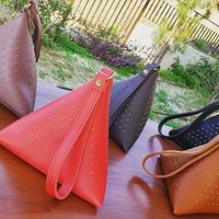 New pyramid clutch bag