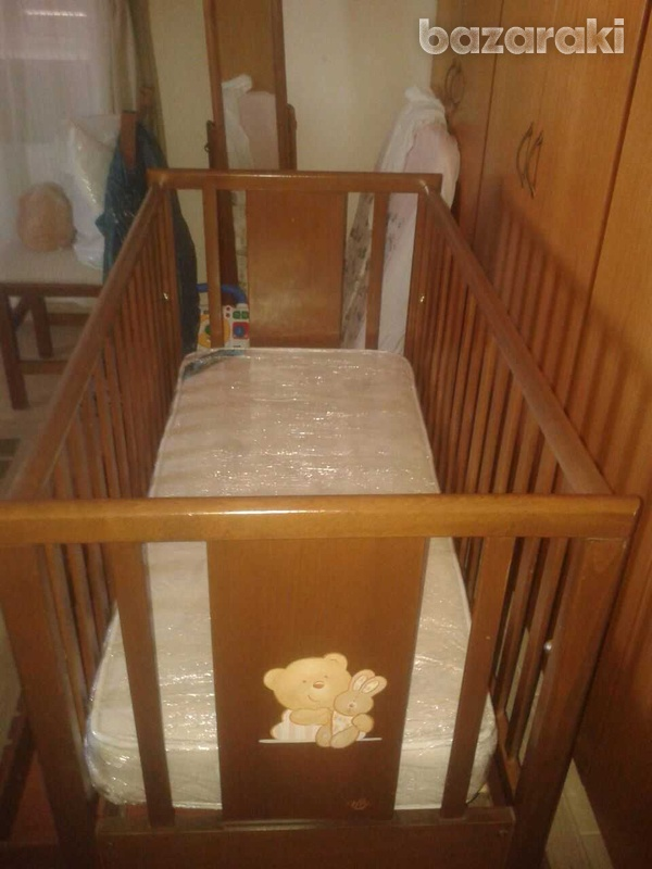 Wooden cot with drop side and drawer-1