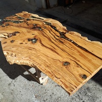 Olive wood slab with epoxy and sea stones