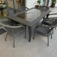 Rattan table with 6 chairs