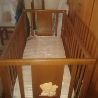 Wooden cot with drop side and drawer