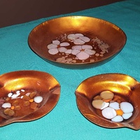 Two copper ashtrays and dish with flower design