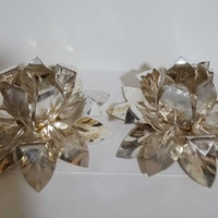 Two silver plated flower-shaped candle holders