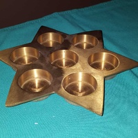 Brass star-shaped tealight candle holder
