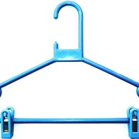 Plastic hangers with pegs.