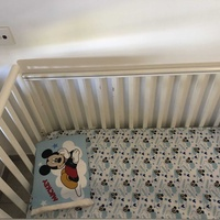 White wood cot bed with mattress