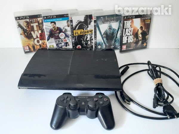 Playstation 3 super slim with 5 games and 1 controller