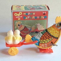 Vintage collectible wind up toy happy paparooster in original box.