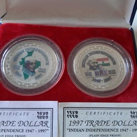Nehru and gandhi coloured trade dollars in case and certificates