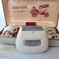 Vintage collectible remington rollectric shaving razor with original c