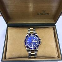 Rolex submariner model with original box and papers