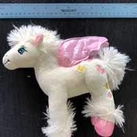 Baby unicorn with butterflies